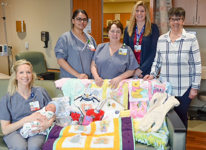 Holy Rosary Council of Catholic Women presents gift of baby items to Aspirus Medford Hospital
