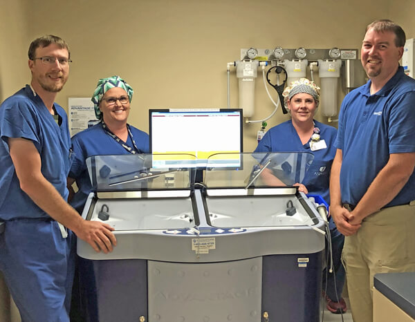 Pictured with the endoscope reprocessor is General Surgeon Clint Semrau, DO; Operating Room Technicians Sara Niemi and Cheryl Kropp; and Aspirus Medford Foundation Chair Randy Juedes.