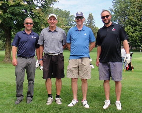 Top honors at the Aspirus Medford Foundation charitable golf tournament went to the Forward Bank with a score of 17 under par. Pictured (from left): Vince Wojcik, Tim Rau, Dave Clark and Luke Dixon.