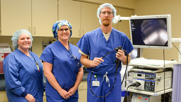 Pictured with Aspirus Medford Hospital's Olympus Endoscope is Lacey Liske, RN; Operating Room Technician Sara Niemi; and General Surgeon Clint Semrau, DO.