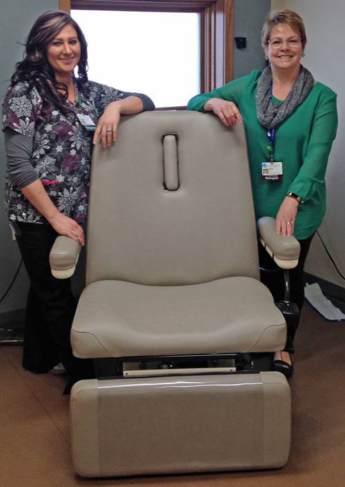 Physical Therapy Technician Katelyn Ziembo and Physical Therapist DeDe Strama with Aspirus Therapy-Medford's new wound care chair